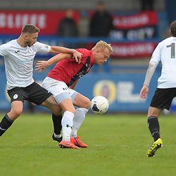 TELFORD COPYRIGHT MIKE SHERIDAN Zak Lilly battles for the ball with Jordan Burrow during the National League North fixture between AFC Telford United and York City at the New Bucks Head on Saturday, October 12, 2019.<br /> <br /> Picture credit: Mike Sheridan<br /> <br /> MS201920-025