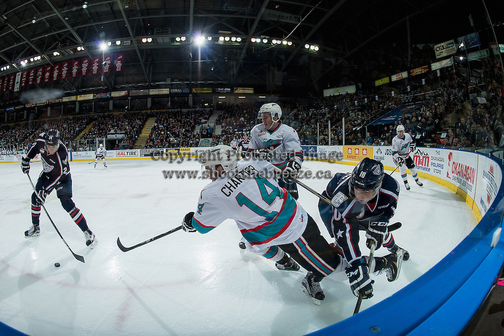 KELOWNA, CANADA - JANUARY 9: Dylan Coghlan #10 of Tri City Americans checks Rourke Chartier #14 of Kelowna Rockets in the corner during first period on January 9, 2016 at Prospera Place in Kelowna, British Columbia, Canada.  (Photo by Marissa Baecker/Shoot the Breeze)  *** Local Caption *** Rourke Chartier; Dylan Coghlan;