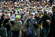 "Fans rush into Autzen Stadium in Eugene on the way to their seats for the start of the Oregon versus Oregon State game often called the ""Civil War."""