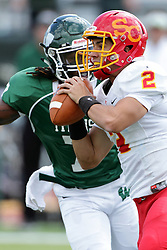 19 September 2015:  Caleb Frye gets hurried by Tyrell Bolden during an NCAA division 3 football game between the Simpson College Storm and the Illinois Wesleyan Titans in Tucci Stadium on Wilder Field, Bloomington IL