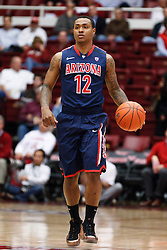 February 3, 2011; Stanford, CA, USA;  Arizona Wildcats guard Lamont Jones (12) dribbles the ball up court against the Stanford Cardinal during the first half at Maples Pavilion.  Arizona defeated Stanford 78-69.