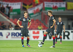 NOVI SAD, SERBIA - Tuesday, September 11, 2012: Wales' captain Aaron Ramsey and David Edwards kick off against Serbia during the 2014 FIFA World Cup Brazil Qualifying Group A match at the Karadorde Stadium. (Pic by David Rawcliffe/Propaganda)