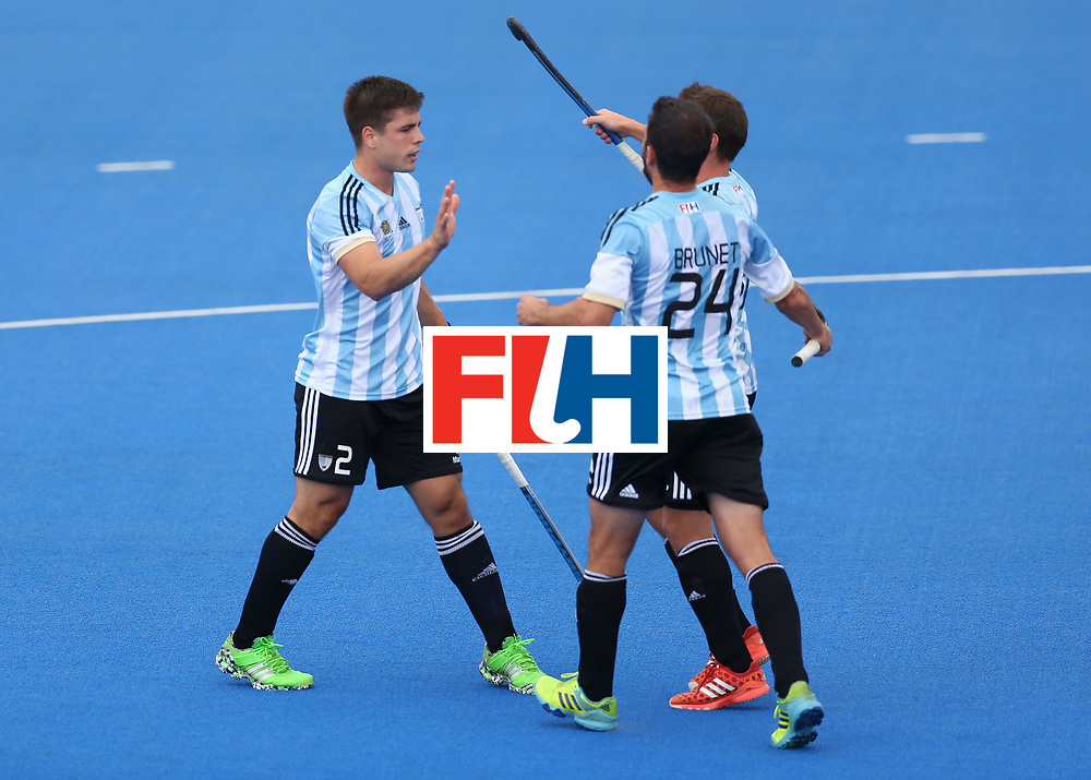 LONDON, ENGLAND - JUNE 24:  Lucas Vila of Argentina (obscured) celebrates scoring their teams first goal with teammates Gonzalo Peillat and Manuel Brunet during the semi-final match between Argentina and Malaysia on day eight of the Hero Hockey World League Semi-Final at Lee Valley Hockey and Tennis Centre on June 24, 2017 in London, England.  (Photo by Steve Bardens/Getty Images)