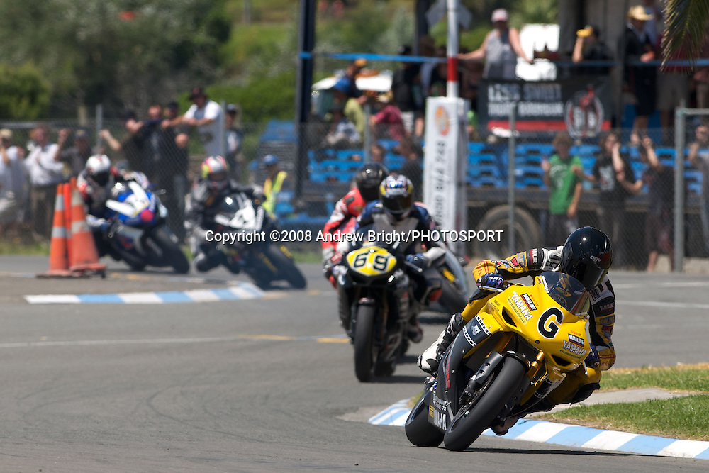 "Australian rider Gareth Jones leads the Formula 1 Superbike field on his Yamaha R1 at Wanganui's annual ""Cemetery Circuit"" motorcycle races on Boxing Day. A fall in the second race saw the class win go to Hamilton's Andrew Stroud (second from left)"