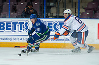 PENTICTON, CANADA - SEPTEMBER 11: Liam Schioler #85 of Edmonton Oilers stick checks Michael Carone #58 of Vancouver Canucks on September 11, 2017 at the South Okanagan Event Centre in Penticton, British Columbia, Canada.  (Photo by Marissa Baecker/Shoot the Breeze)  *** Local Caption ***