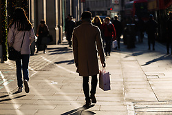 London's Regent Street is busy with shoppers even though high street retailers are facing their quietest Christmas since the credit crunch. London, December 13 2018.