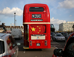 © Licensed to London News Pictures. 20/10/2015. London, UK. A London bus is decorated with a Chinese flag as the State Visit to the United Kingdom by Chinese President Xi Jinping gets under way . Photo credit: Peter Macdiarmid/LNP