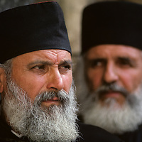Israel, Jerusalem, Portrait of Greek Orthodox Christian priests outside Church of the Holy Sepulcher