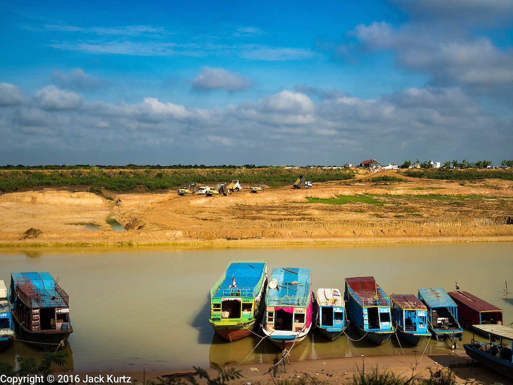 31 MAY 2016 - SIEM REAP, CAMBODIA: Boats for tourists in the Seam Reap River, which leads to the Tonle Sap Lake. Much of the Cambodian interior is dealing with the worst drought in living memory. The Tonle Sap Lake is lower than it's ever been and the canals that take boat traffic into the lake are too low for all but the smallest boats to use.    PHOTO BY JACK KURTZ