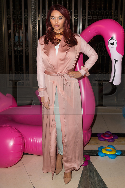 © Licensed to London News Pictures. 17/09/2016.  AMY CHILDS attends the ASHLEY ISHAM Spring/Summer 2017 show. Models, buyers, celebrities and the stylish descend upon London Fashion Week for the Spring/Summer 2017 clothes collection shows. London, UK. Photo credit: Ray Tang/LNP