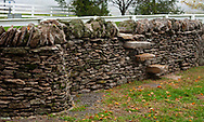 Photo of steps on a stone fence. Stone fence construction classes are part of the educational programs at Shaker Village in Mercer County Ky