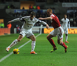 Swansea City's  shields the ball from Fulham's Steve Sidwell - Photo mandatory by-line: Alex James/JMP - Tel: Mobile: 07966 386802 28/01/2014 - SPORT - FOOTBALL - Liberty Stadium - Swansea - Swansea City v Fulham - Barclays Premier League