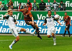 16.04.2011, Volkswagen Arena, Wolfsburg, GER, 1.FBL, VfL Wolfsburg vs FC St. Pauli, im Bild Ralph Gunesch (St. Pauli #11) kommt zum schuss Simon Kjaer (Wolfsburg #34) und Makoto Hasebe (Wolfsburg #13) kommen zu spaet .EXPA Pictures © 2011, PhotoCredit: EXPA/ nph/  Schrader       ****** out of GER / SWE / CRO  / BEL ******