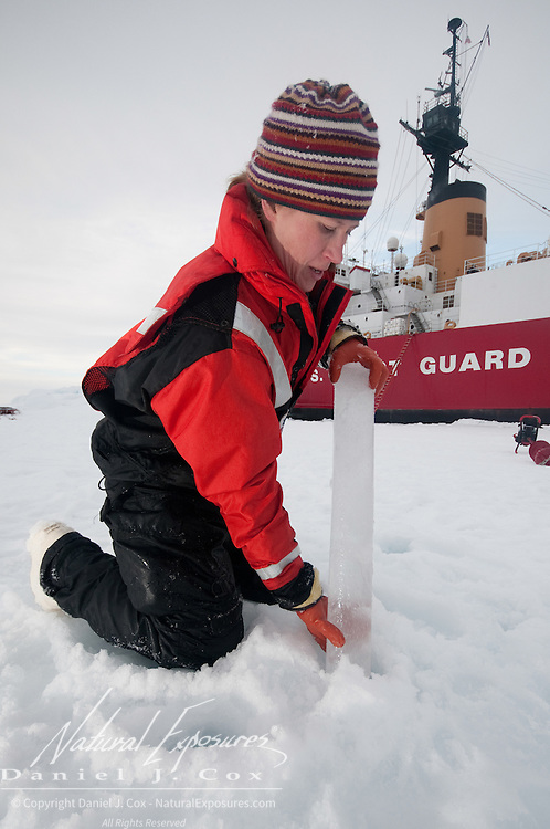 Mette Kaufman pulls up an ice core sample. Arctic Ocean