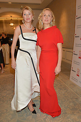 Left to right, LYUBA GALKINA and DINA KORZUN at the Gift of Life Gala Ball celebrating the Russian Old new Year's Eve in aid of the Gift of Life foundation held at The Savoy, London on 13th January 2015.