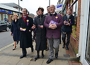 © Licensed to London News Pictures. 12/02/2013. Eastleigh, UK NIGEL FARAGE (L) and DIANE JAMES (centre) . Diane James, chosen yesterday to fight the Eastleigh by election for UKIP, campaigns with Nigel Farage, leader of the party, in Easleigh's Market Street today 12th February 2013. Photo credit : Stephen Simpson/LNP