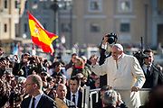 Pope Francis waves during his weekly audience at St.Peter's Square in Vatican city, on November 8, 2017.