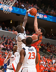 Virginia center Assane Sene (5) blocks a shot by Virginia Tech guard/forward A.D. Vassallo (40).  The Virginia Cavaliers defeated the Virginia Tech Hokies 75-61 at the John Paul Jones Arena on the Grounds of the University of Virginia in Charlottesville, VA on February 18, 2009.