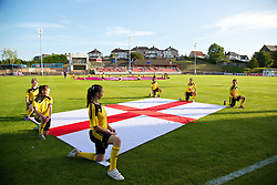 LLANELLI, WALES - Monday, August 19, 2013: England's flag bearers before the Group A match of the UEFA Women's Under-19 Championship Wales 2013 tournament at Stebonheath Park. (Pic by David Rawcliffe/Propaganda)