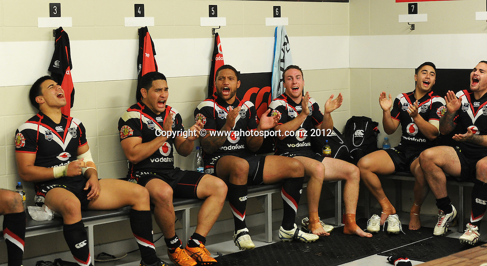Warriors players sing the team song in the dressing room after defeating the Broncos during the NRL Rugby League match, Vodafone Warriors v Brisbane Broncos at Mt Smart Stadium, Auckland, New Zealand on Saturday 5 May 2012. Photo: Andrew Cornaga/photosport.co.nz