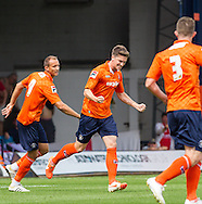 Alex Lacey of Luton Town (centre) celebrates scoring the opening goal during the Pre Season Friendly match at Kenilworth Road, Luton<br /> Picture by David Horn/Focus Images Ltd +44 7545 970036<br /> 26/07/2014