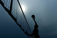 A silhouette of a member of Sports Academy for teens playing the male final round during a tournament in Santa Monica, Calif on Nov. 12, 2017.