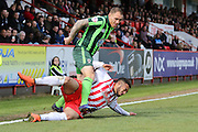 Jake Mulraney midfielder for Stevenage FC (29) slides in on Barry Fuller (Captain) defender for AFC Wimbledon (2) during the Sky Bet League 2 match between Stevenage and AFC Wimbledon at the Lamex Stadium, Stevenage, England on 30 April 2016. Photo by Stuart Butcher.
