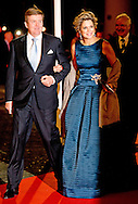 1-2-2014  ROTTERDAM NETHERLANDS  King willem alexander and queen maxima  arrives  for the celebration party for Queen Beatrix to thank fed for being 33 years the Queen of the Netherlands COPYRIGHT ROBIN UTRECHT