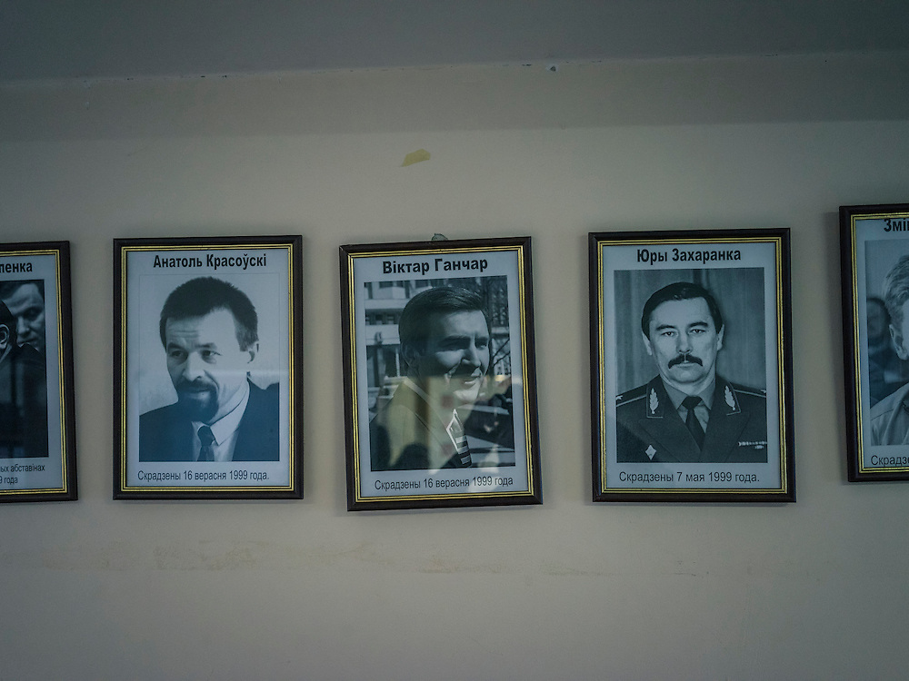 Pictures of disappeared politicians and journalists hang on the wall of the office at the United Civic Party of Belarus on Monday, November 23, 2015 in Minsk, Belarus.