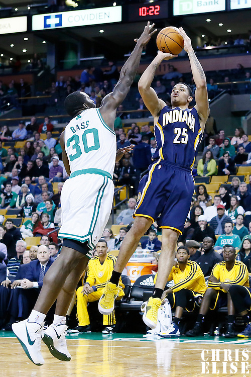 04 January 2013: Indiana Pacers small forward Gerald Green (25) takes a jumpshot over Boston Celtics power forward Brandon Bass (30) during the Boston Celtics 94-75 victory over the Indiana Pacers at the TD Garden, Boston, Massachusetts, USA.