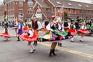 Goshen, New York - The Pokolenie Dancers perfom in front of the viewing stand on Main Street during the 40th annual Mid-Hudson St. Patrick's Parade on March 13, 2016.