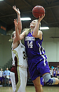 Coe's Mary Halvorson (32) tries to block a shot by Cornell's Camille Marie-Lidd (44) during their Iowa Conference semifinal game at Eby Fieldhouse in Cedar Rapids on Thursday evening, February 23, 2012. Coe won 69-58. (Stephen Mally/Freelance)