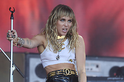 © Licensed to London News Pictures. 30/06/2019. Glastonbury , UK. Miley Cyrus performs on the Pyramid stage on the last day of the Glastonbury Festival in Somerset. Photo credit: Jason Bryant/LNP
