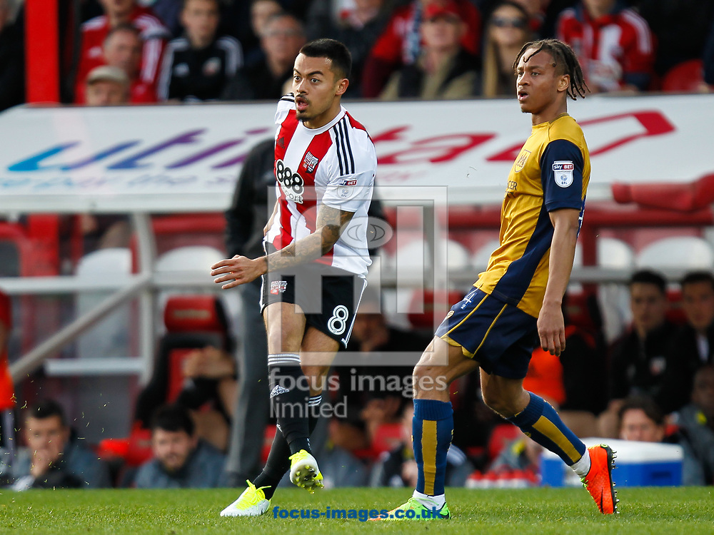 Nico Yennaris of Brentford and Bobby Reid of Bristol City during the Sky Bet Championship match between Brentford and Bristol City at Griffin Park, London<br /> Picture by Mark D Fuller/Focus Images Ltd +44 7774 216216<br /> 01/04/2017