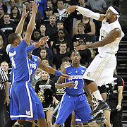 Central Florida guard Marcus Jordan (5) passes the basketball against Memphis guard Charles Carmouche (4) and Memphis guard Antonio Barton (2) during a Conference USA NCAA basketball game between the Memphis Tigers and the Central Florida Knights at the UCF Arena on February 9, 2011 in Orlando, Florida. Memphis won the game 63-62. (AP Photo: Alex Menendez)