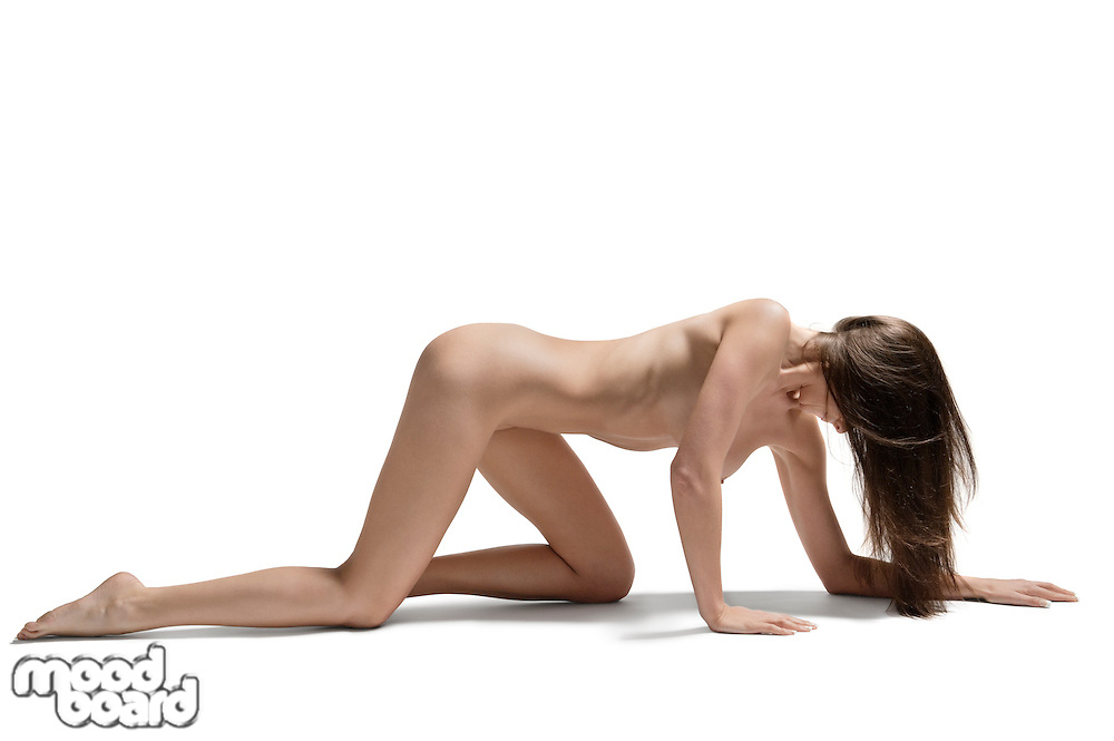 Young woman crawling on hands and knees naked over white background