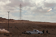 Libyan rebel fighters fire a rocket during a battle with pro-Qaddafi forces just outside the coastal town of Bin Jawwad. Rebels fought pro-Qaddafi forces there throughout the day as they tried to regain control the town from government forces that seized the town overnight..