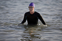 Woman in wetsuit in water