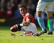 Nani holds his ankle during the Barclays Premier League match between Manchester United and Manchester City at Old Trafford on February 12, 2011 in Manchester, England.