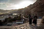 Tibetans walk along a mountain pathway on their way to Rabgya monestary in Golock region, Tibet (Qinghai, China). The monestary is home to around 500 monks of the Gelukpa sect.