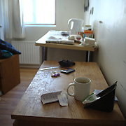 Nikkunj's temporary accommodation is small without room for a chair.