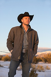 cowboy on a ranch at sunset