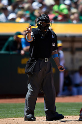 OAKLAND, CA - JUNE 21:  MLB umpire Chris Segal #96 calls a strike during the fourth inning between the Oakland Athletics and the Los Angeles Angels of Anaheim at O.co Coliseum on June 21, 2015 in Oakland, California. The Oakland Athletics defeated the Los Angeles Angels of Anaheim 3-2. (Photo by Jason O. Watson/Getty Images) *** Local Caption *** Chris Segal
