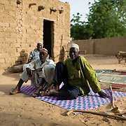 Men relaxing in the village of Gadirga in the Commune of Soukoukoutan in the Dosso Region of Niger on 23 July 2013.