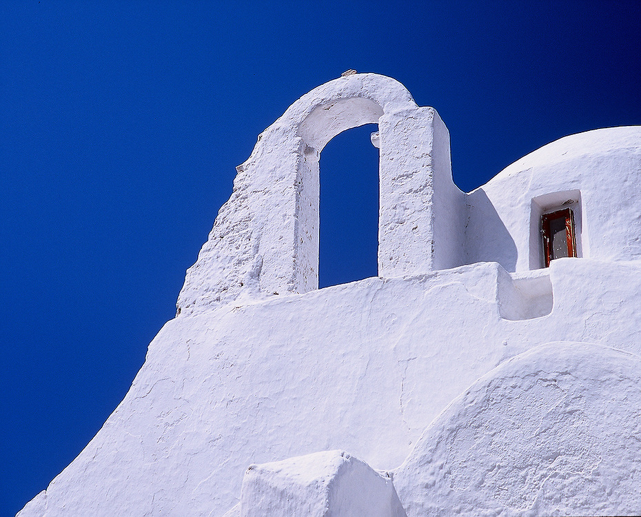 White building against blue sky in Mykonos, Greece