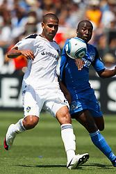 August 21, 2010; Santa Clara, CA, USA;  Los Angeles Galaxy defender Leonardo (22) is defended by San Jose Earthquakes forward Cornell Glen (13) during the first half at Buck Shaw Stadium.