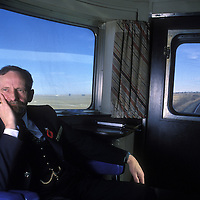 Canada, Alberta, (MR) Veteran conductor Jeff Sykes sits in caboose of VIA Rail passenger train near Calgary