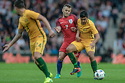 Massimo Luongo (Australia) and Jack Wilshere (England) during the Friendly International match match between England and Australia at the Stadium Of Light, Sunderland, England on 27 May 2016. Photo by Mark P Doherty.