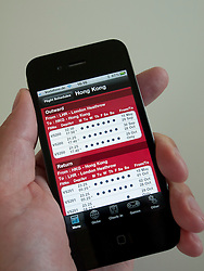 Man using app to book flights with Virgin airline on an iPhone 4G smart phone