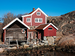 Wooden house and boathouse in traditional red colour in Lysekil town on Swedens west Bohuslan coast 2009